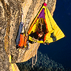 Rock climbing tent hanging from cliff
