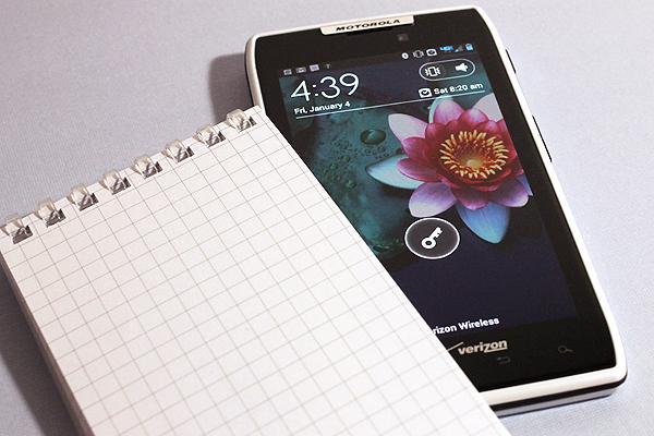 Open spiral notepad versus locked smartphone