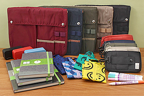 New Products: Bag in Bags, Pouches, Notebooks, Screen Cleaners, Fabric Markers, and More!